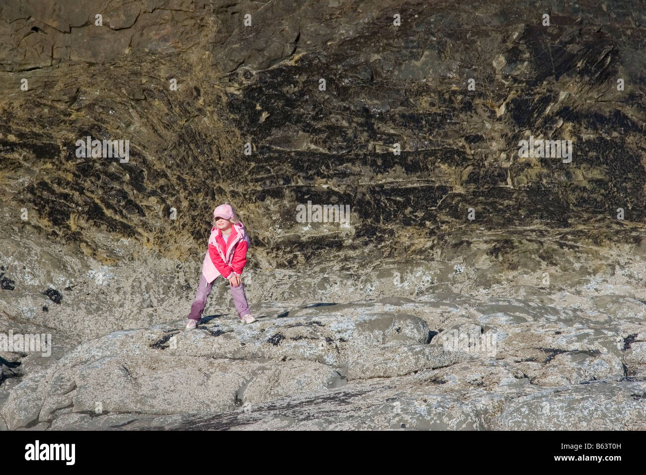 A young hiker at Hole in the Wall Rialto Beach Olympic National Park Washington - Stock Image