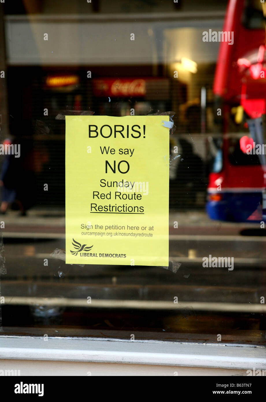 Anti-Red Route poster in shop window, Holloway Road, London - Stock Image
