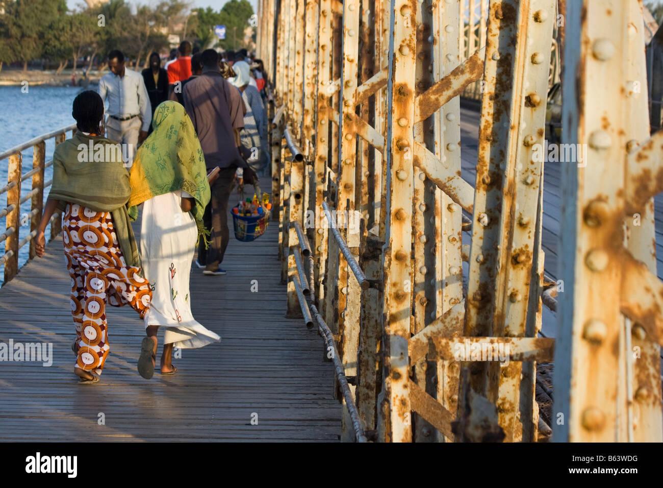 People Walking on the Faidherbe Bridge in St Louis in Senegal Africa - Stock Image