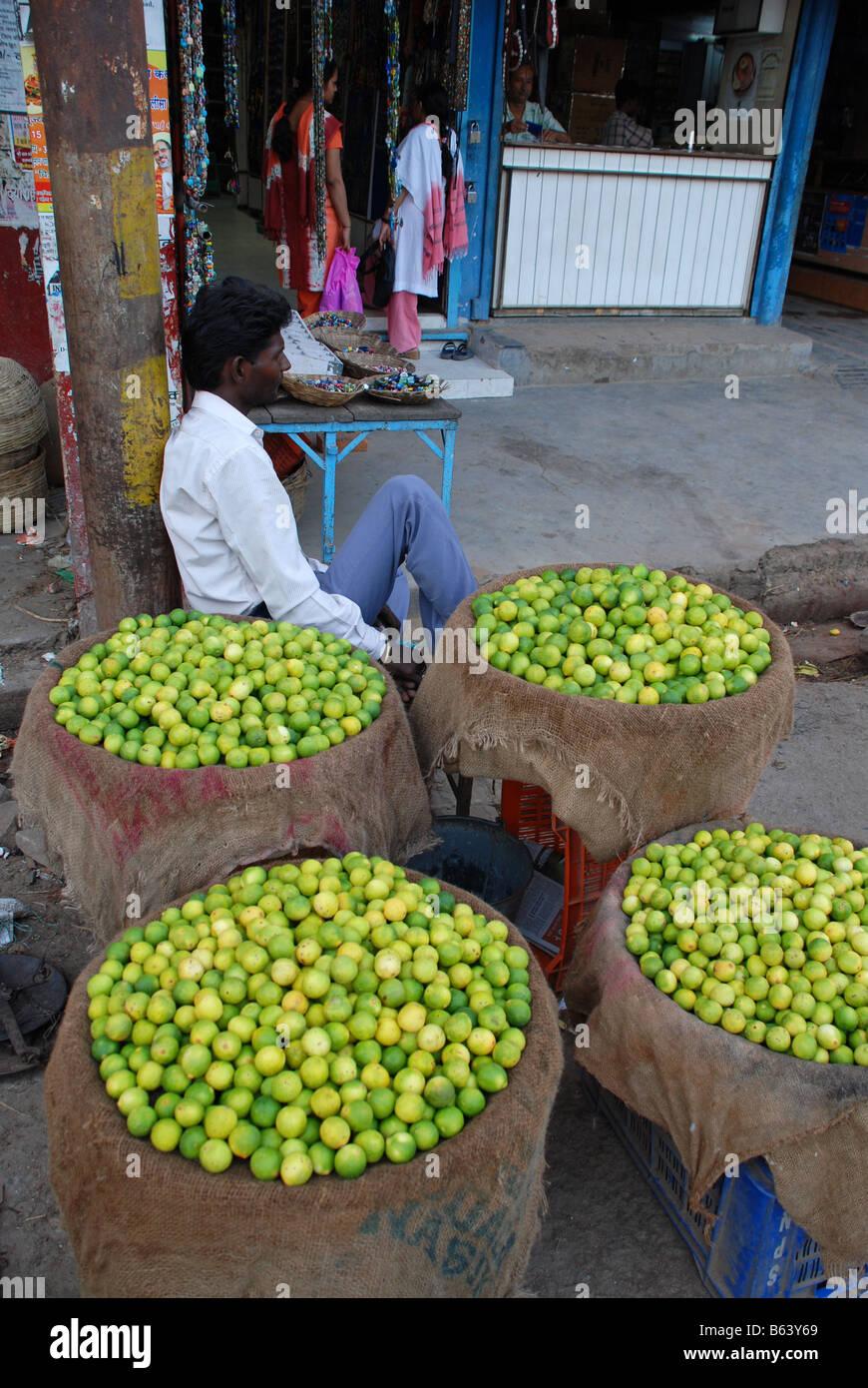 Lime street seller in Varanasi, India. - Stock Image