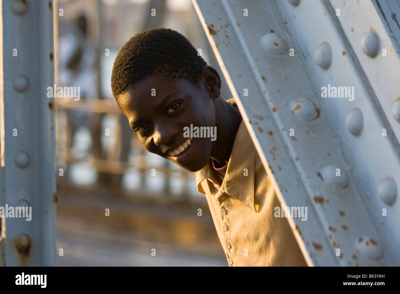 Senegalese Boy on the Faidherbe Bridge in St Louis in Senegal Africa - Stock Image