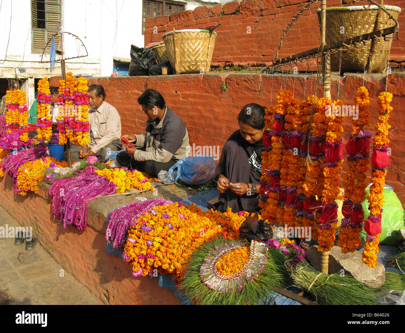 Flower garlands being prepared for Tihar (Diwali) in Durbar Square, Kathmandu, Bagmati, Himalayas, Nepal, central - Stock Image