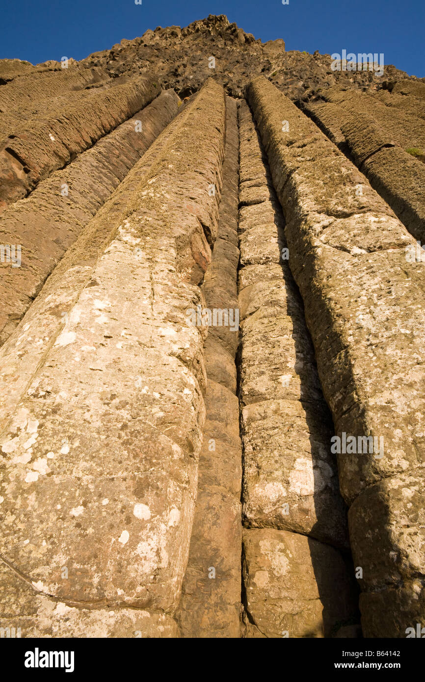 Organ Pipes: Long tubes of hexagonal basalt soar to make a vertical cliff in the formation known as the organ pipes - Stock Image