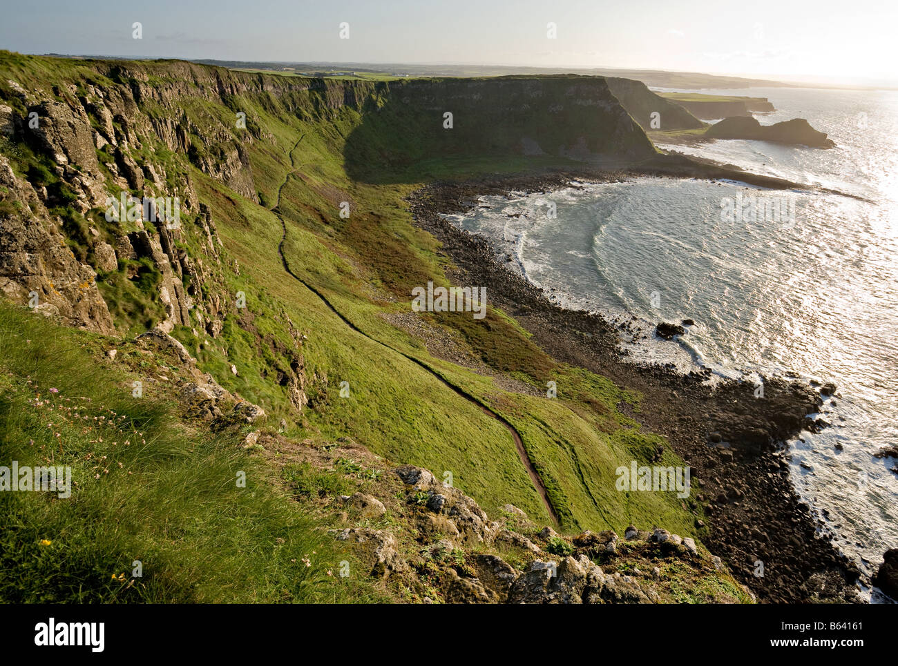 Cliffs and Headlands looking west of the Causeway. The cliff above and the headlands beyond the path to the giant's - Stock Image