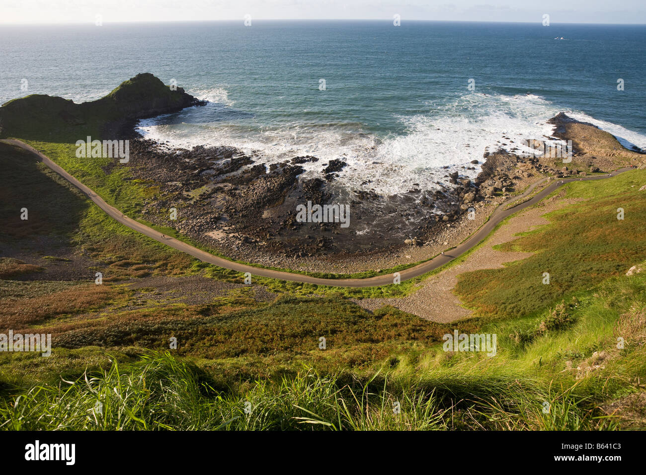 Coastal Footpath Curve: The curve of the path as it curves down from the visitor centre skirting the pounding waves Stock Photo