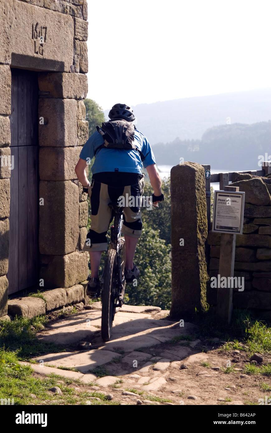 Mountain biking in the Peak District National Park Derbyshire visit tourist tourism Stock Photo