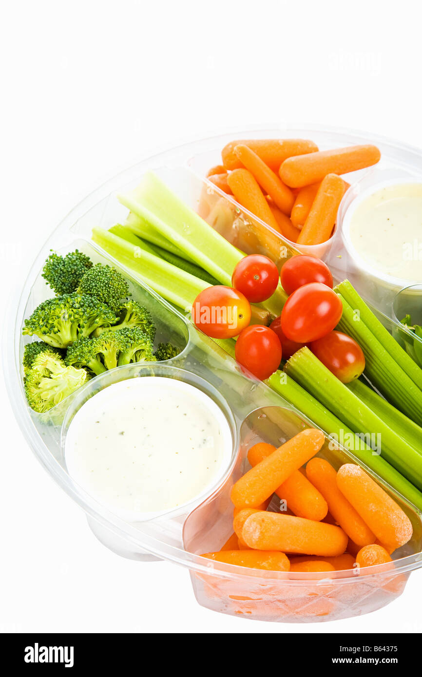 Party tray of fresh veggies and dip isolated on white with clipping path Stock Photo