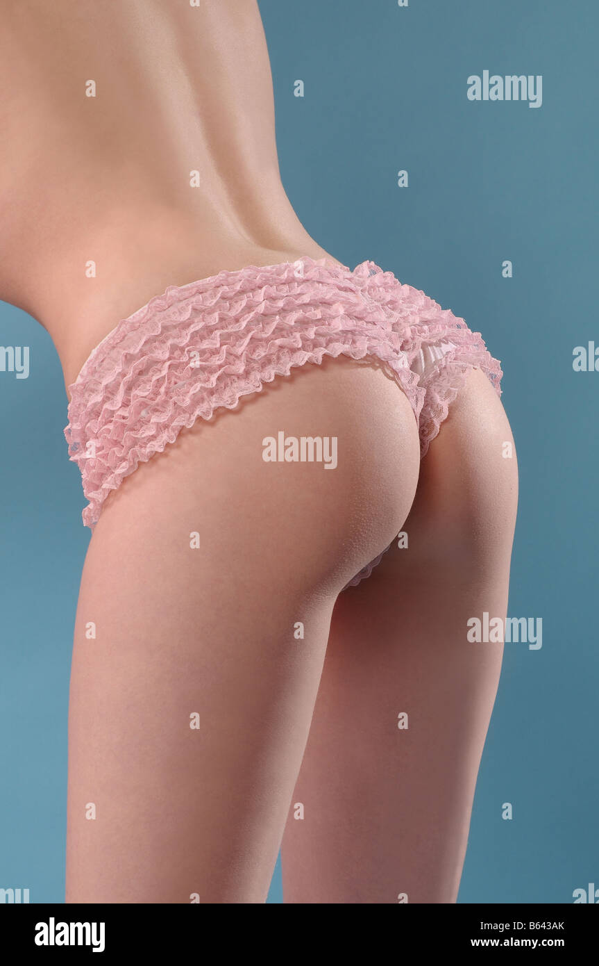 Close up of woman wearing frilly knickers - Stock Image