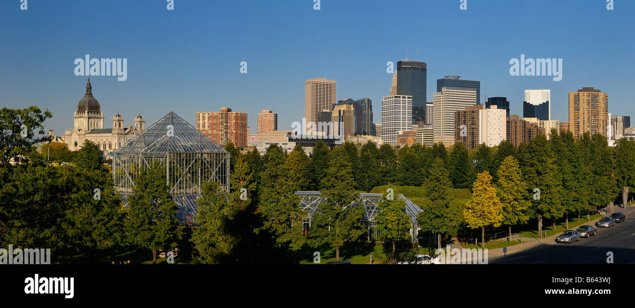 Minneapolis cityscape panorama from the Sculpture Garden Greenhouses with Cathedral and Highrise towers - Stock Image