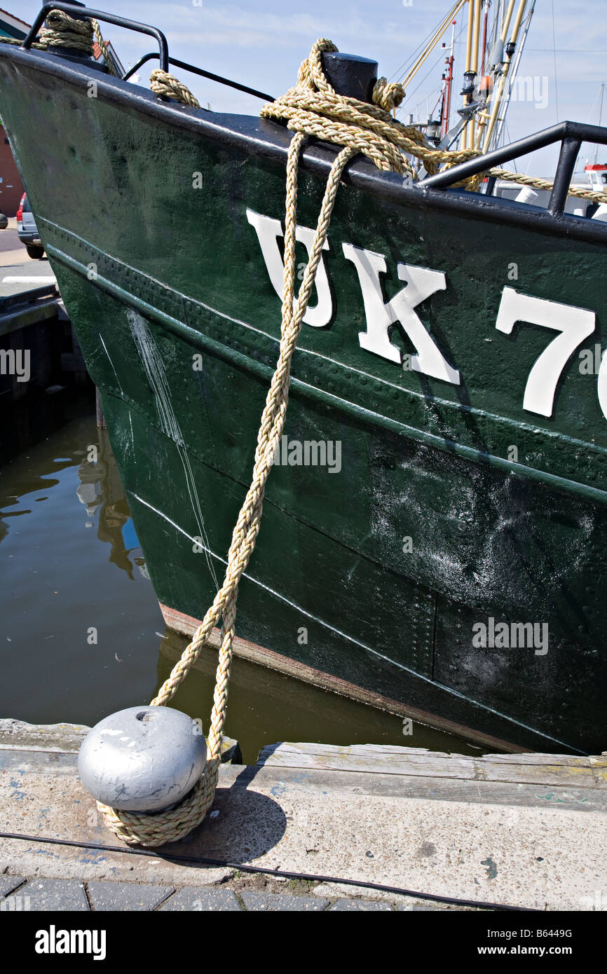 Prow of boat registered in Urk tied to capstan Urk Netherlands - Stock Image