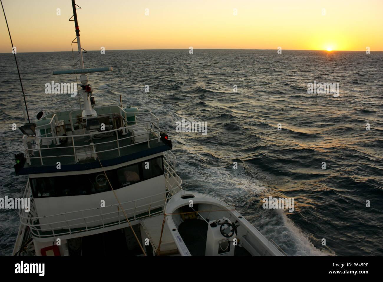 Crab fishing boat stock photos crab fishing boat stock for Deep sea fishing half moon bay