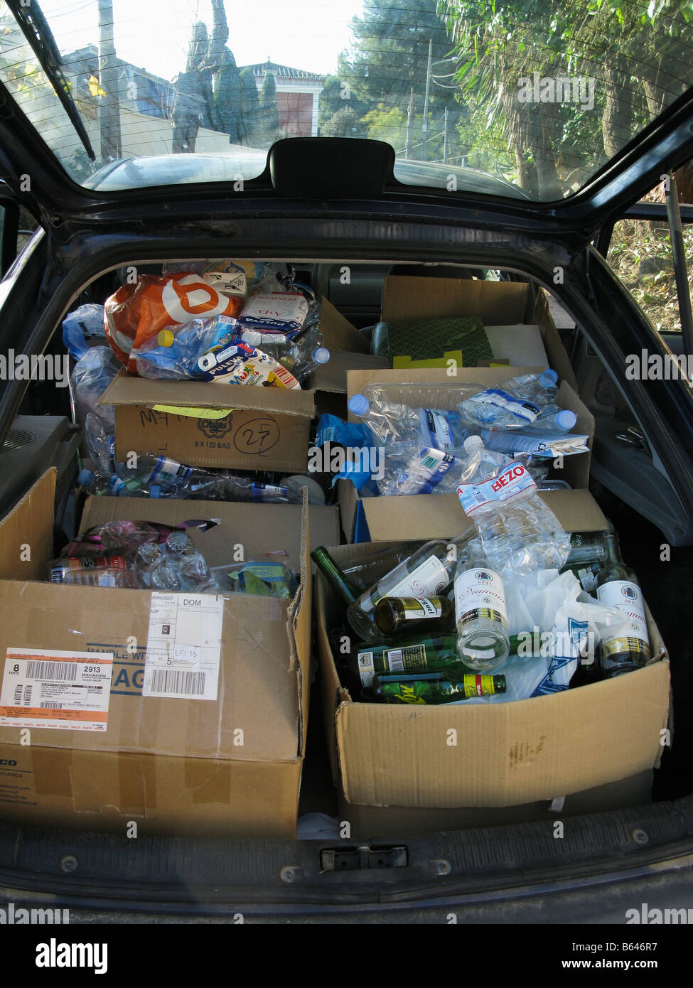 Car boot full of recyclable rubish - Stock Image