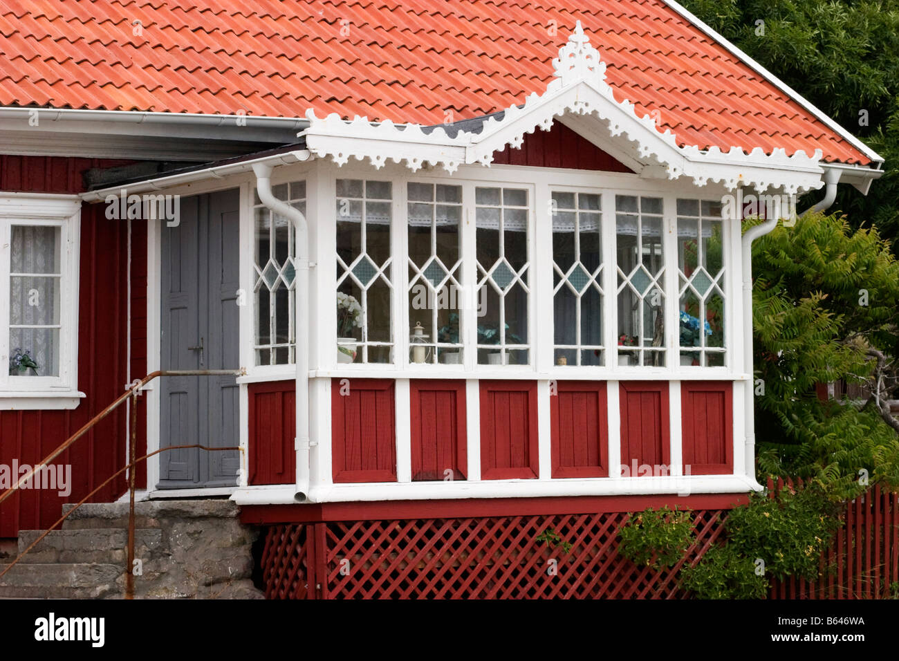 Red Cottage With A Porch   Stock Image