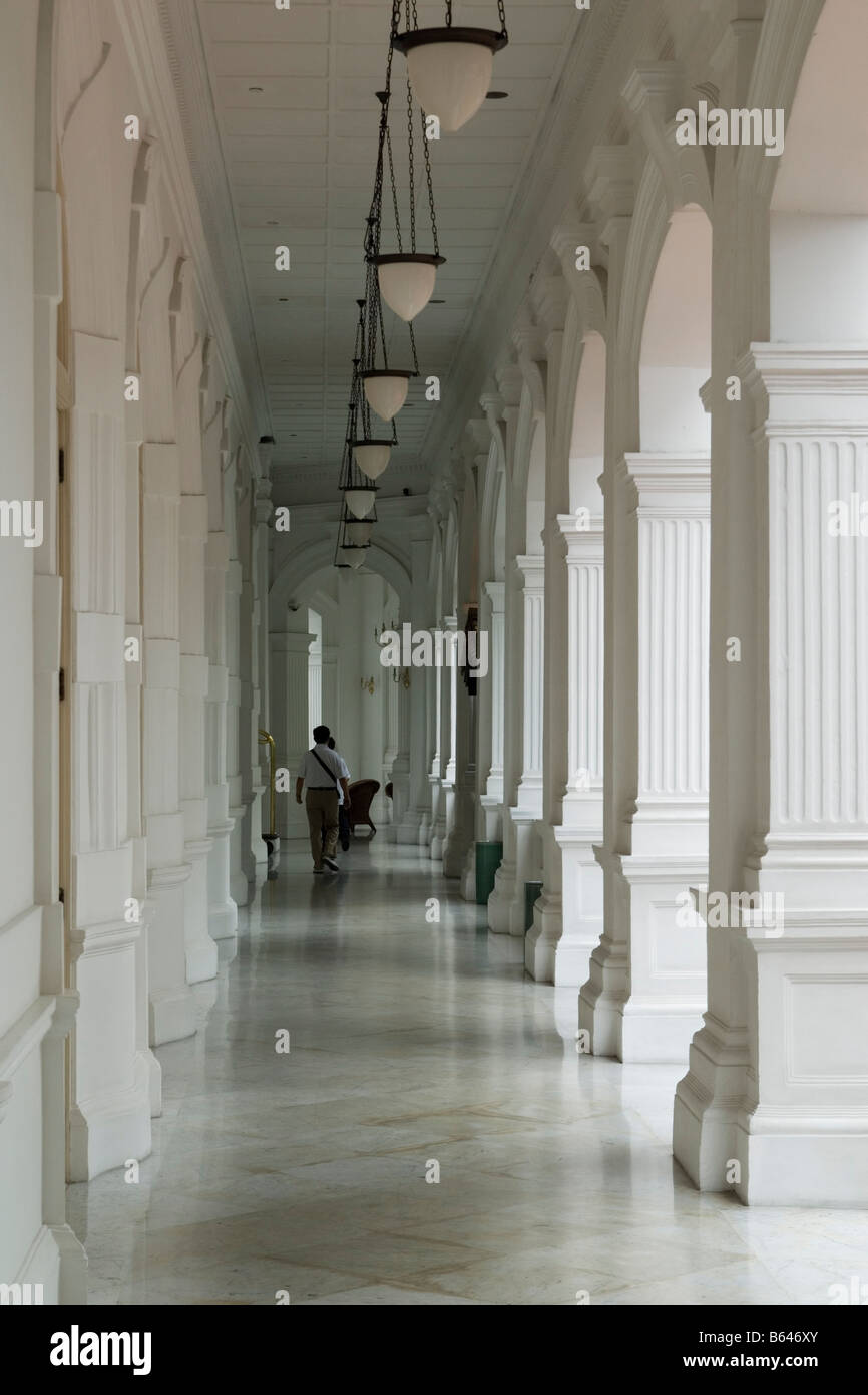 Columned porch of the Raffles Hotel, Singapore - Stock Image