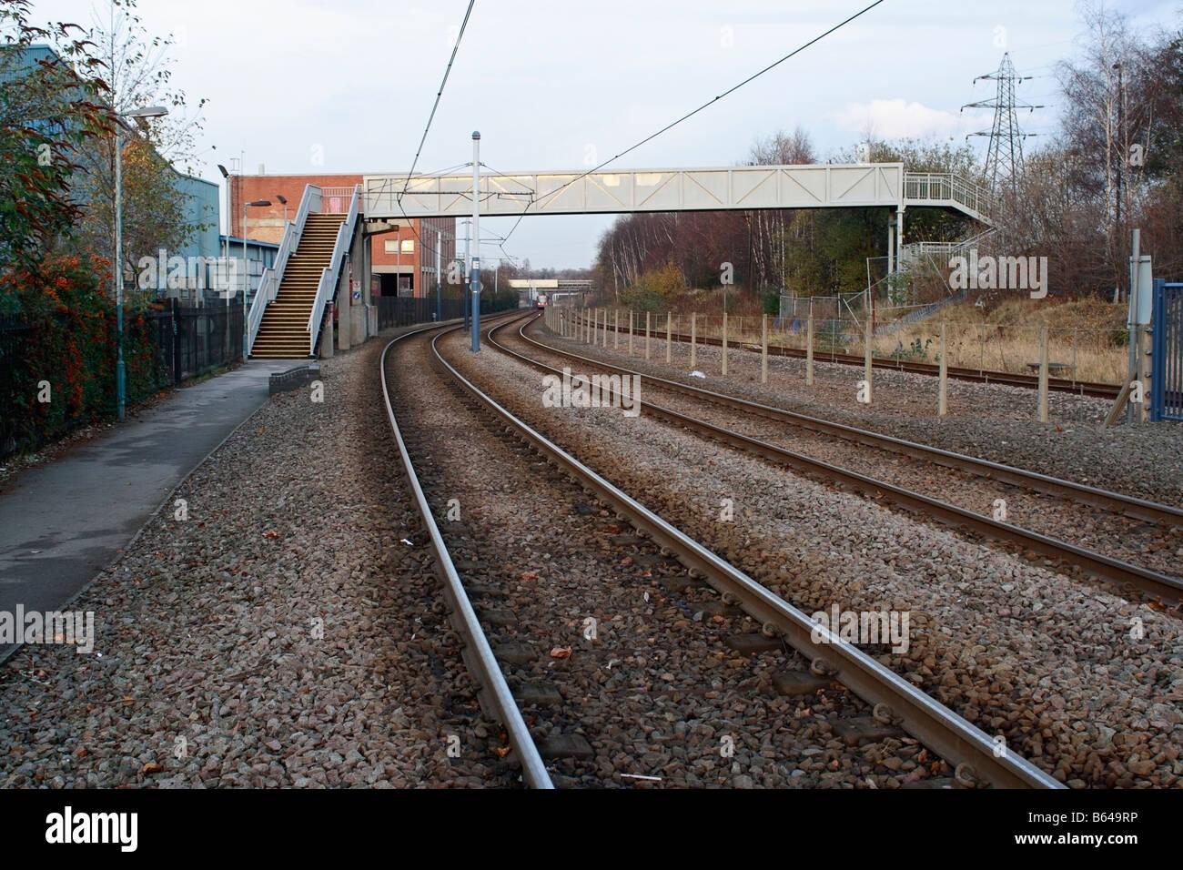 Footbridge across Light rail network in Sheffield - Stock Image