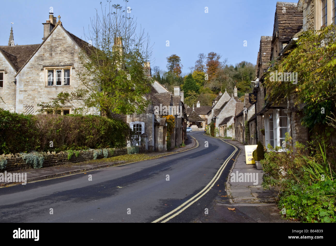 Picturesque village of Castle Combe in the Cotswolds, England taken on a fine autumn day, showing the main street. - Stock Image