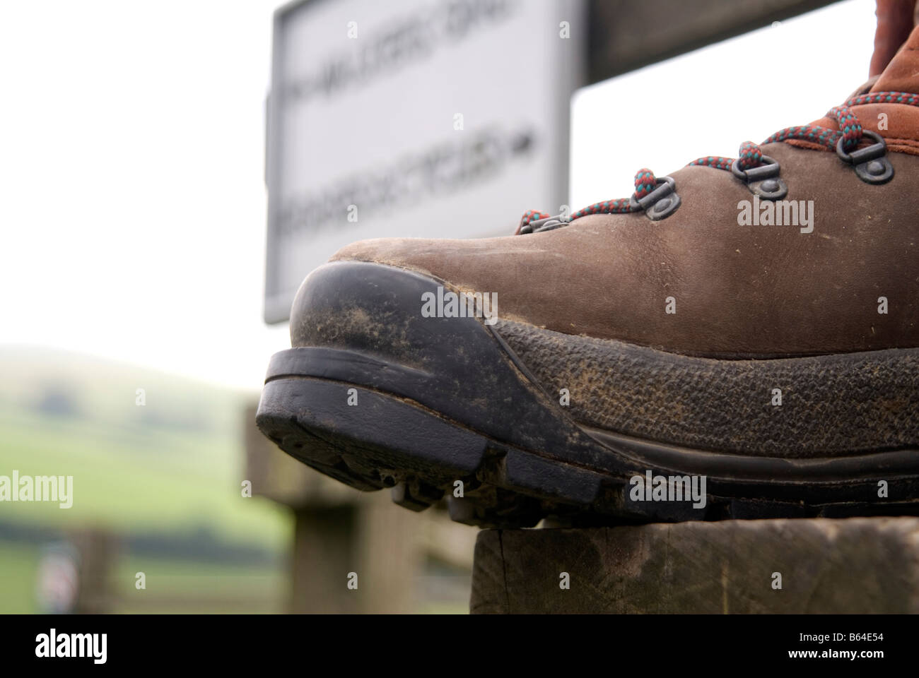 walking boot on a style in the Peak District National Park Derbyshire visit tourist tourism Peak District National - Stock Image