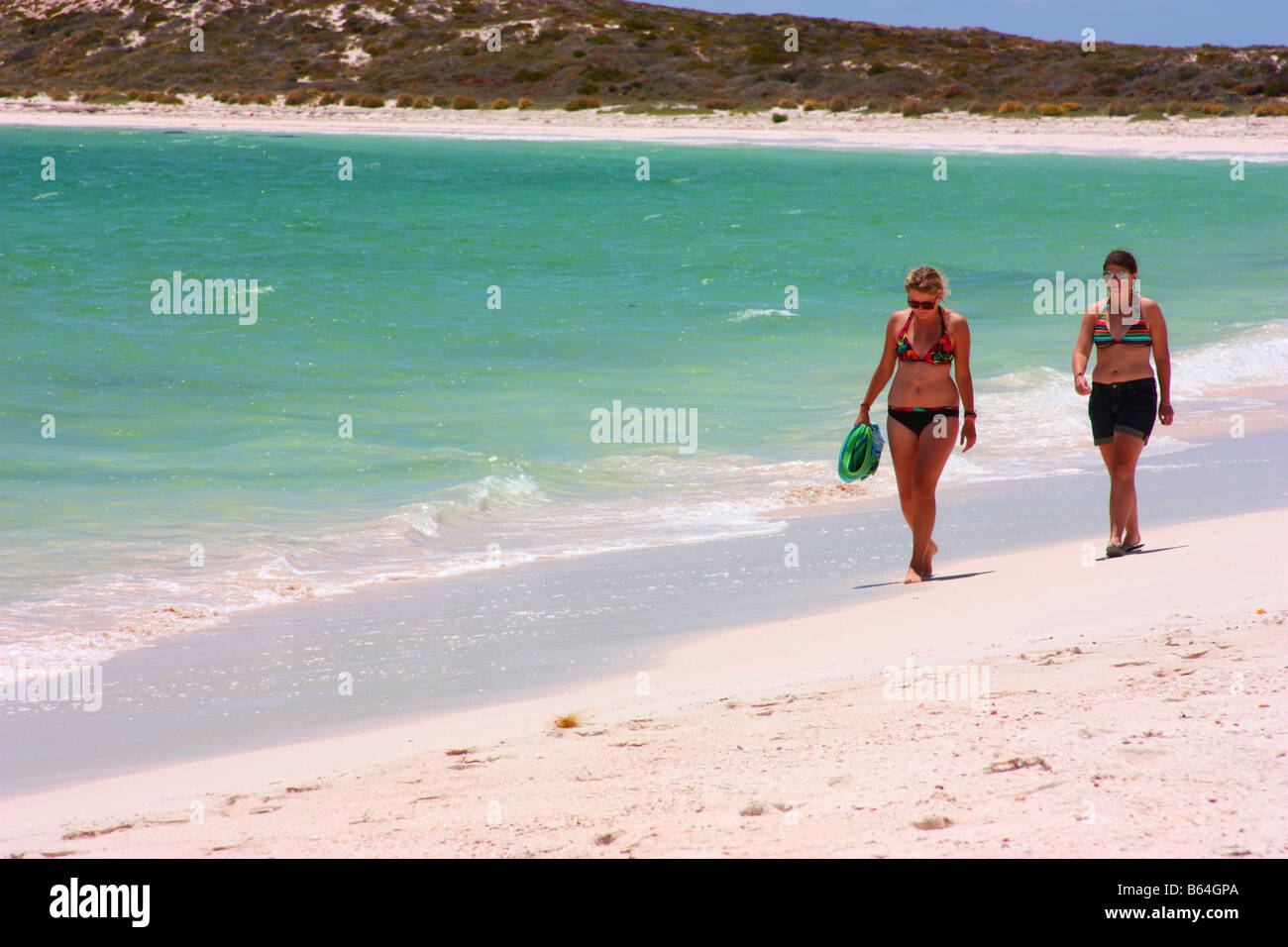 two people on the beach at east wallabi island in the abrolhos islands - Stock Image