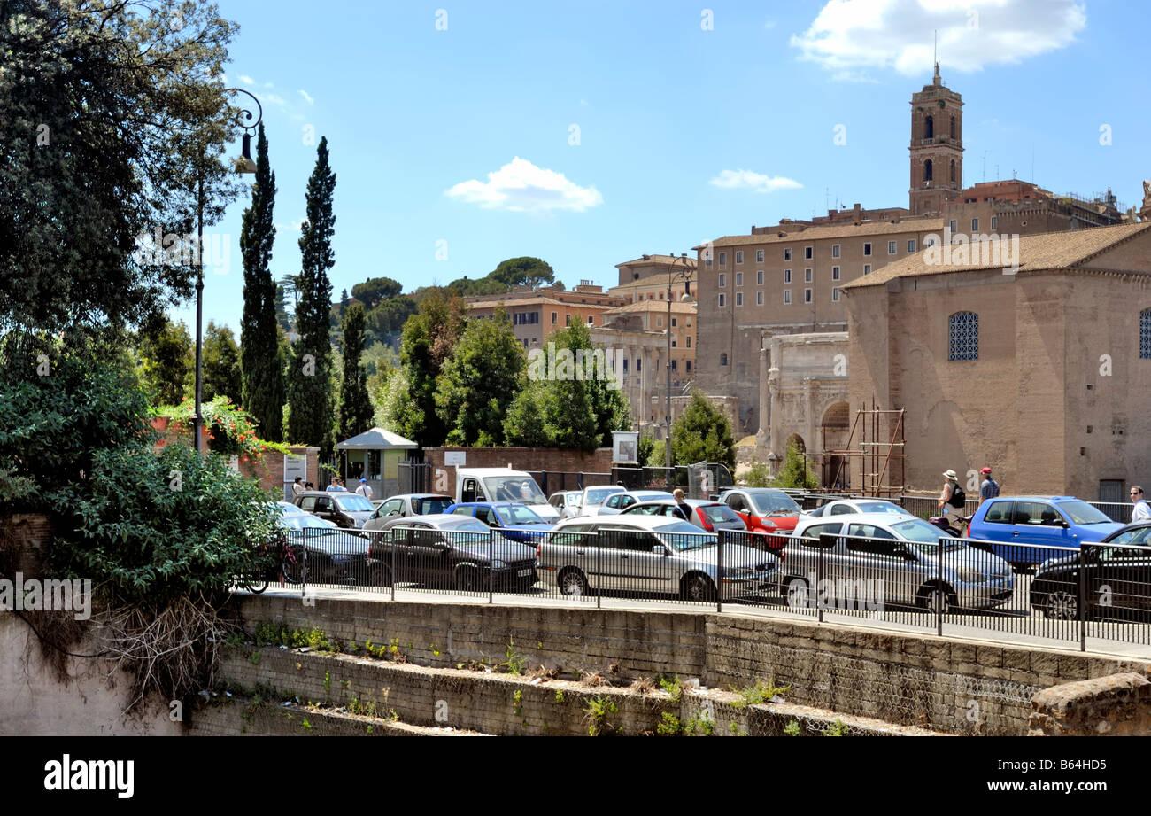 The Roman Forum, Foro Romano, the ticket office and entrance gate from Via dei Fori Imperiali, Rome, Lazio, Italy, - Stock Image