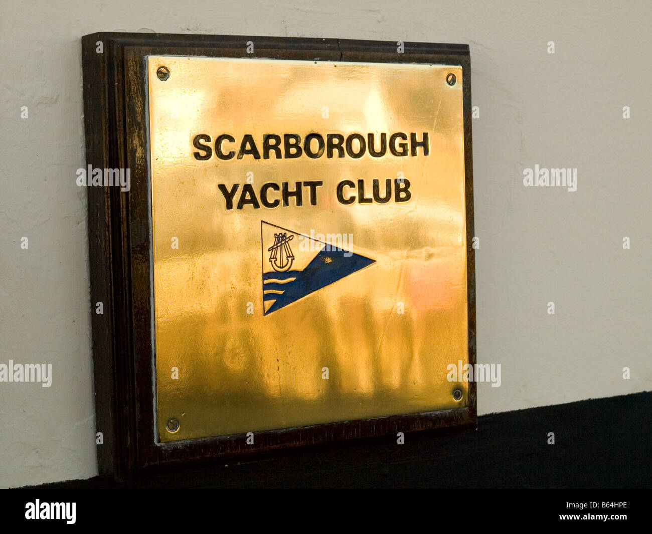 Polished brass plate at Scarborough Yacht Club UK - Stock Image