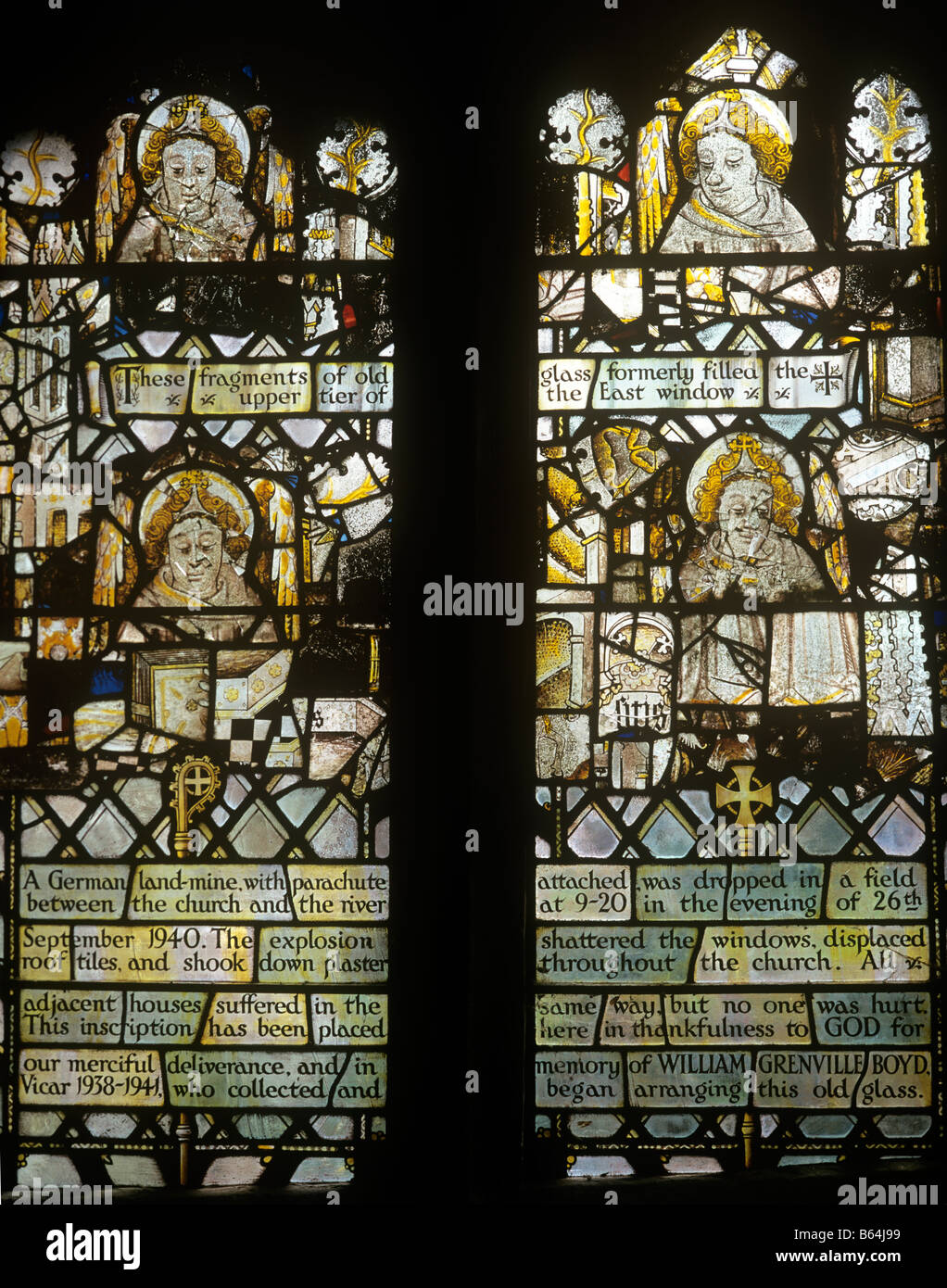 UK England Oxfordshire Swinbrook medieval glass fragments in church window - Stock Image