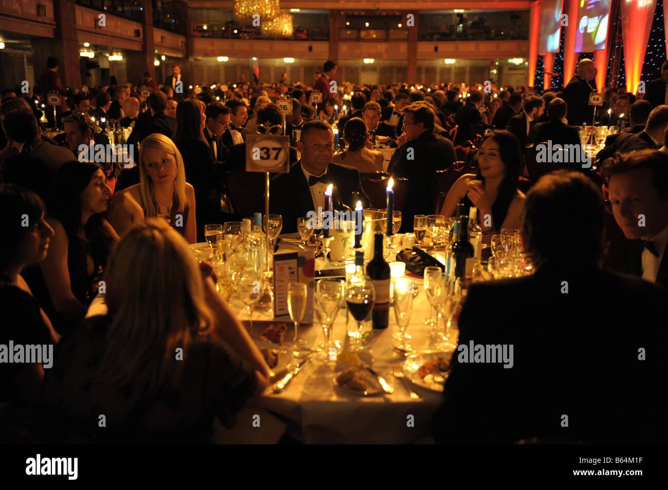 Dinner table at large evening function - Stock Image