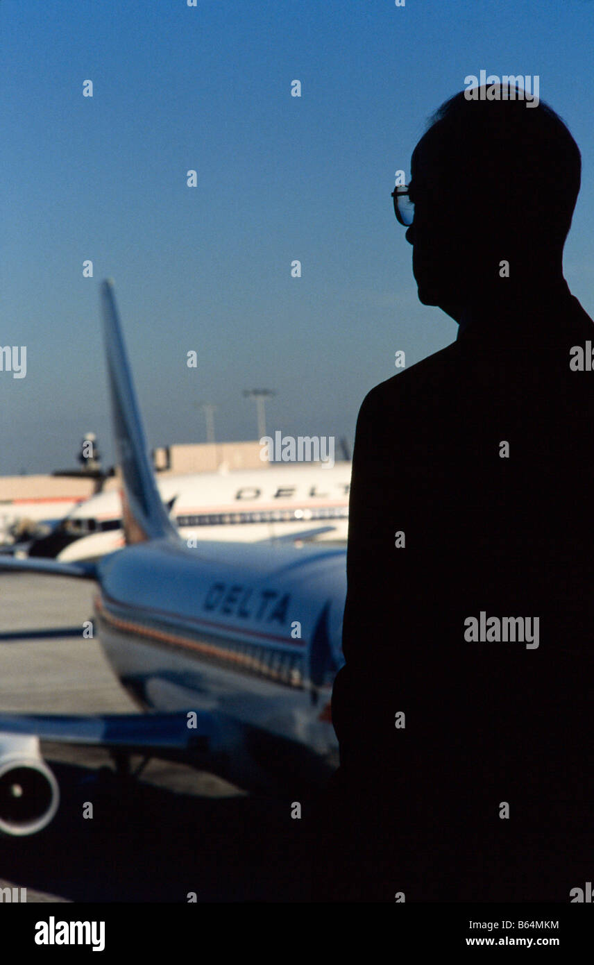 Commercial Airliner parked at Terminal,Passengers in terminal awaiting flights  Hartsfield International , Atlanta, - Stock Image