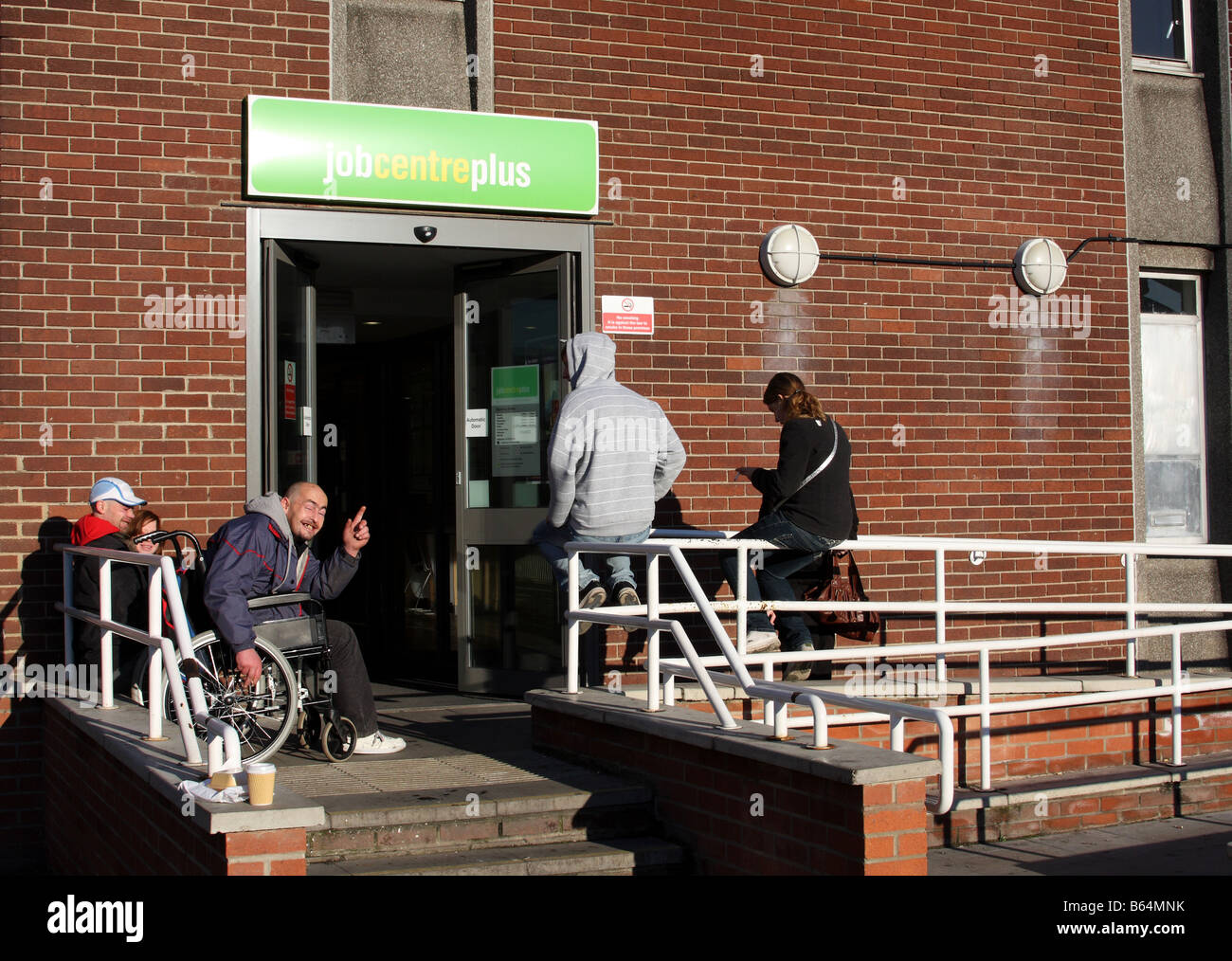 People waiting outside a Job Centre Plus, Station Street, Nottingham, England, U.K. - Stock Image