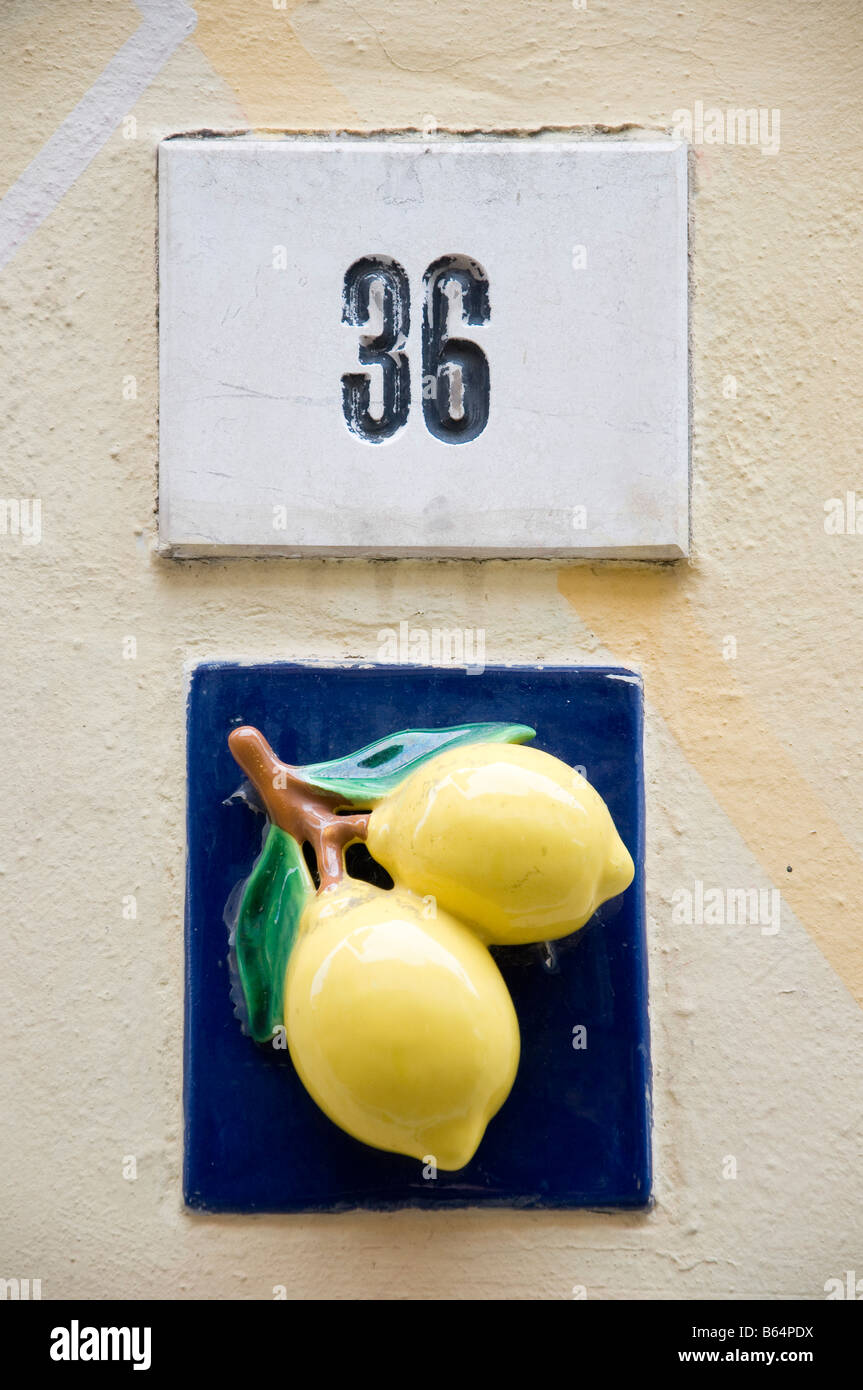 Ceramic tile house number stock photos ceramic tile house number house number and lemons on a ceramic tile limone sul garda lake garda italy stock dailygadgetfo Images