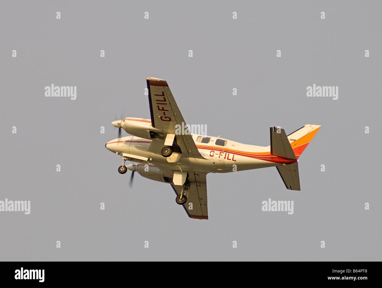 Piper PA-31-310 Navajo Aeroplane leaving Inverness Airport Scotland SCO 2002 Stock Photo