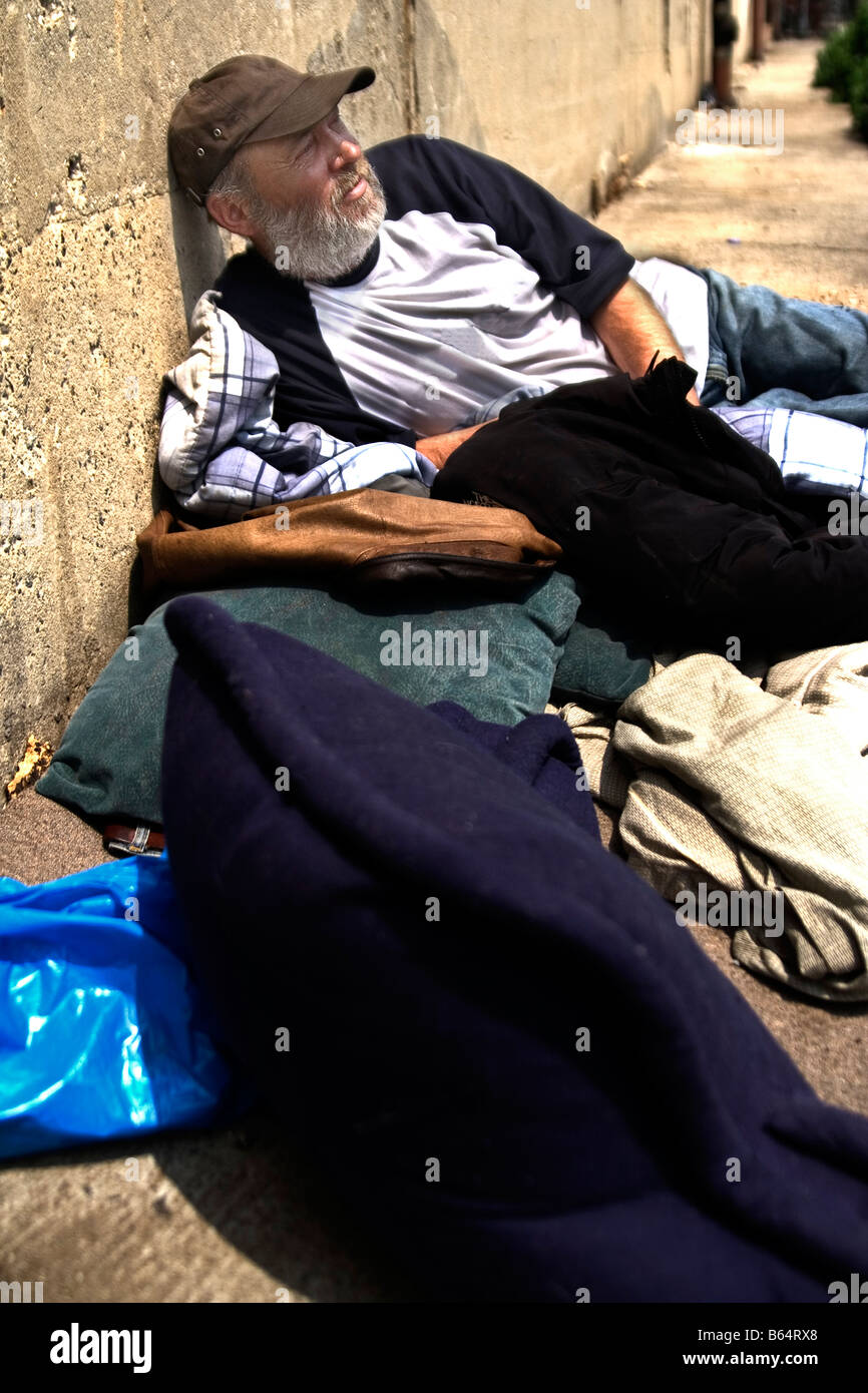 Homeless Man lying on its bed. Brooklyn, NY, USA - Stock Image