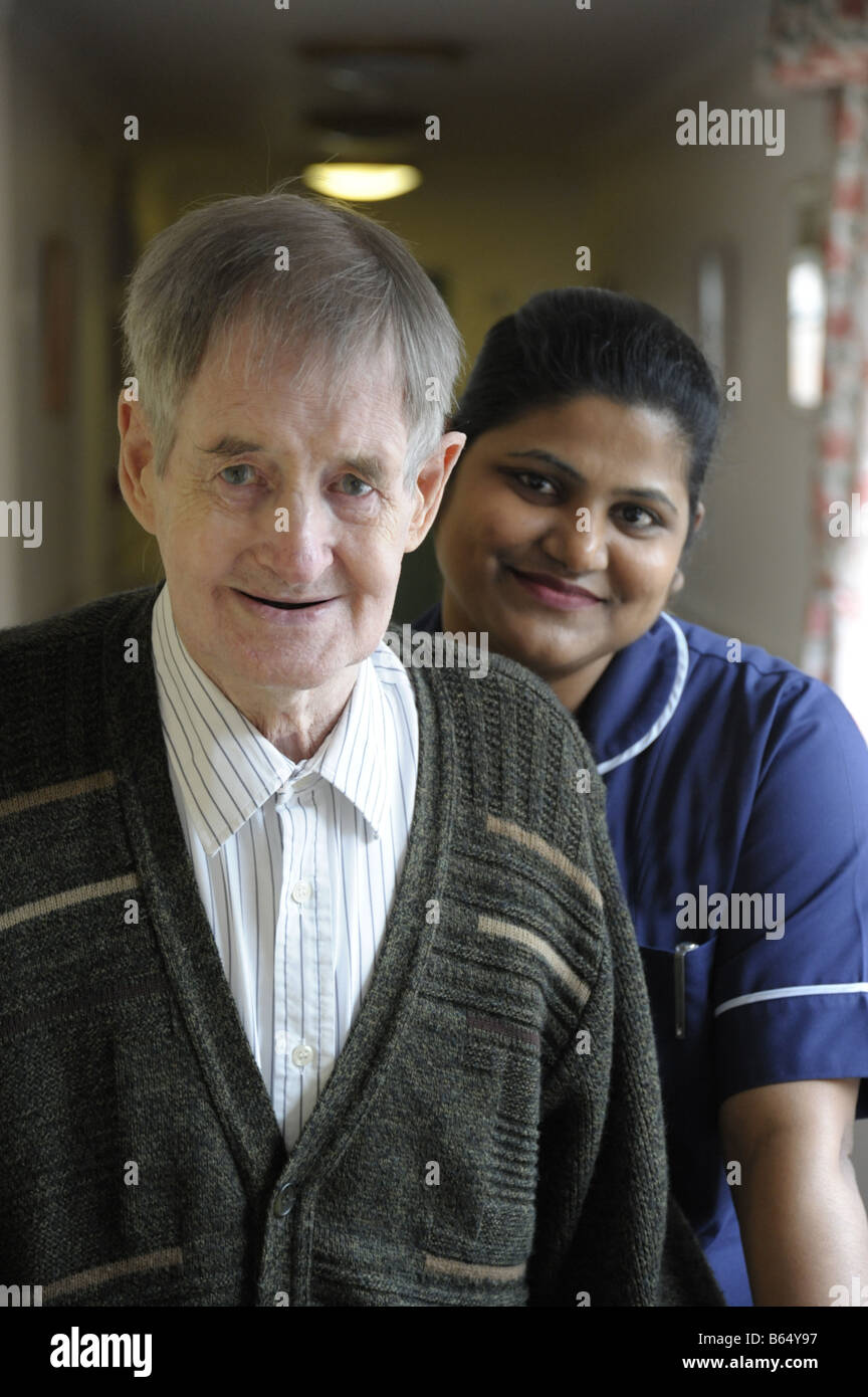 Senior man with nurse in background - Stock Image
