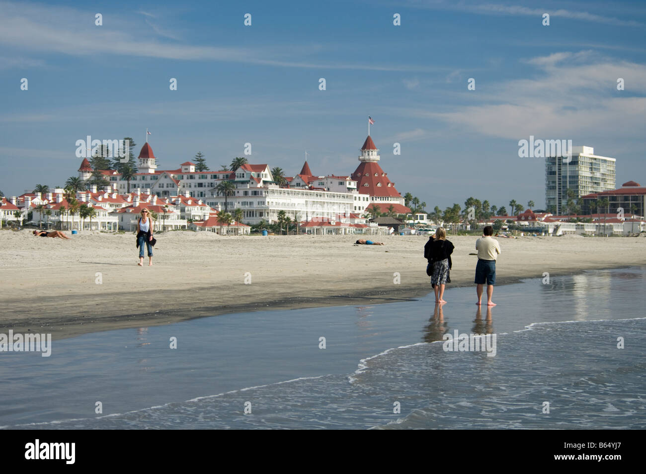 People walk on the beach in front of the Hotel del Coronado Coronado San Diego California no MRs Stock Photo