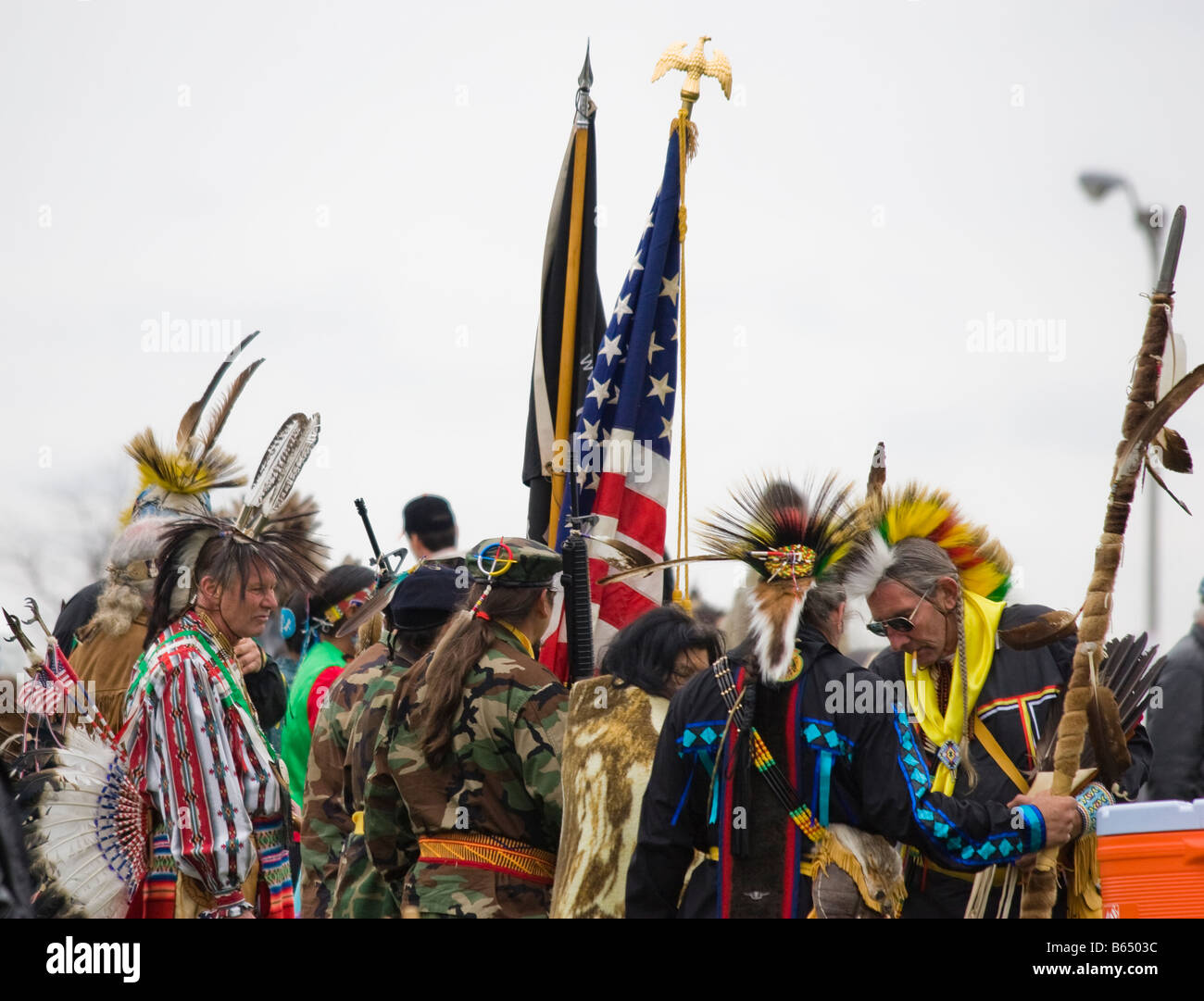 Native Americans at the Healing Horse Spirit PowWow in Mt. Airy, Maryland carry an American flag POW-MIA flag. Stock Photo