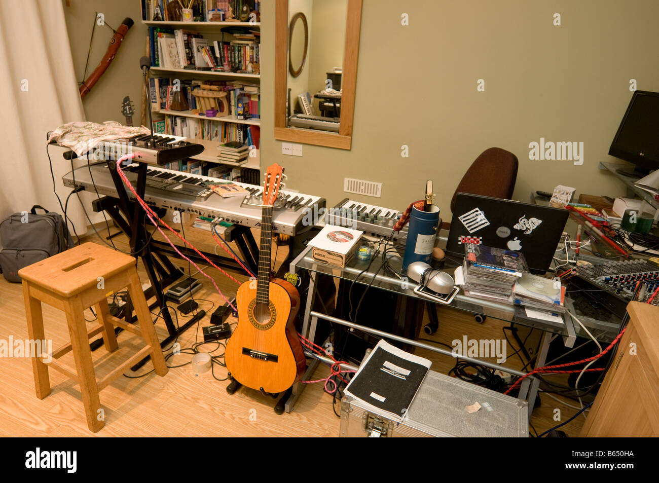Teenage Boy Musician Music Room And Home Recording Studio Full Of Keyboards Electronic Equipment UK