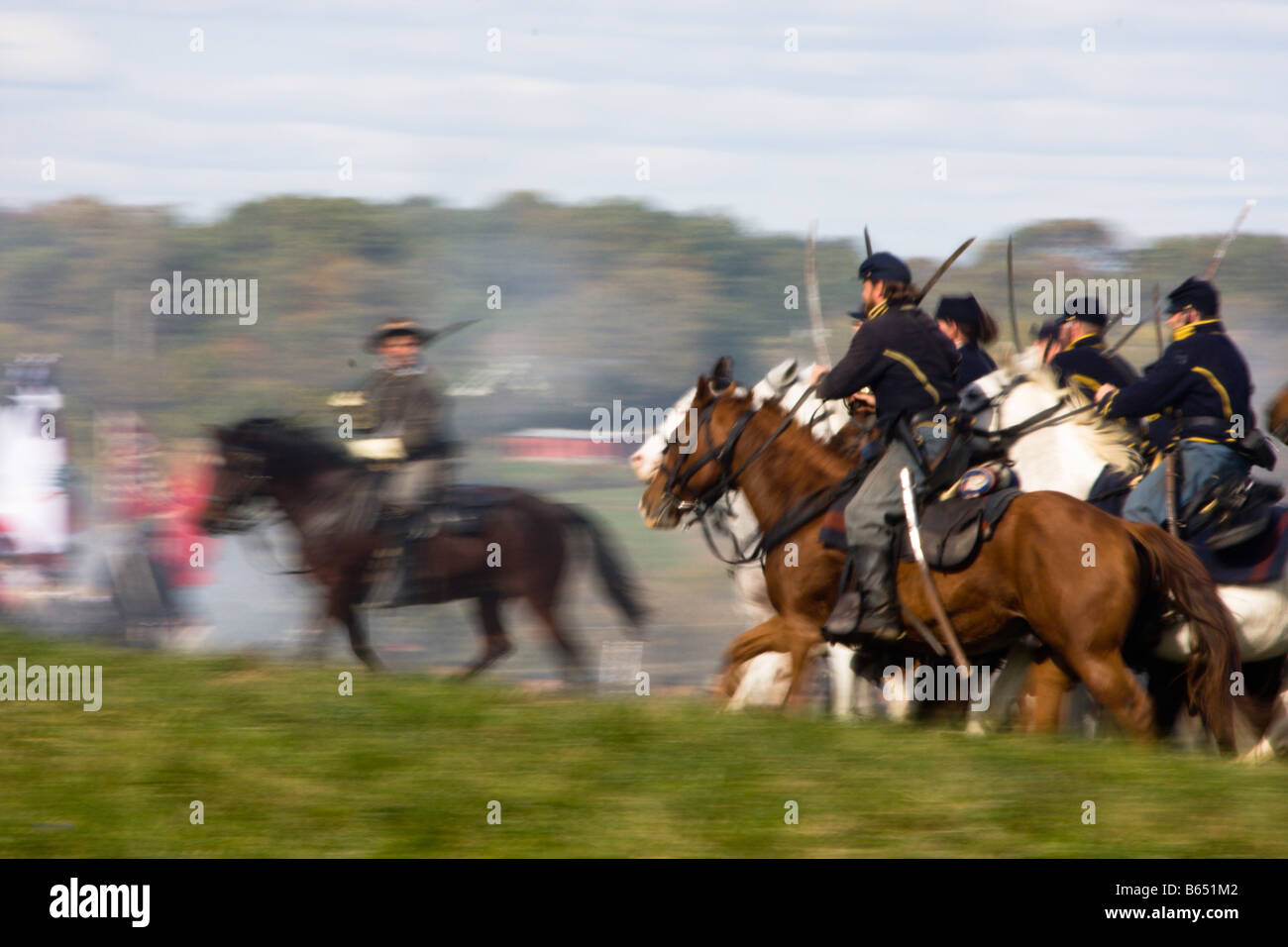 Federal cavalry, sabres drawn, at the renactment of the Battle of Berryville. - Stock Image