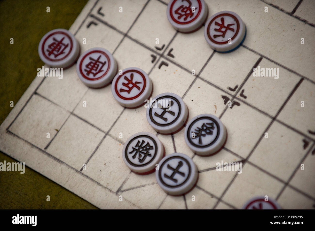 Pieces of the Chinese game Xiang qi, or Chinese chess, is pictured at a street in Hong Kong, China - Stock Image
