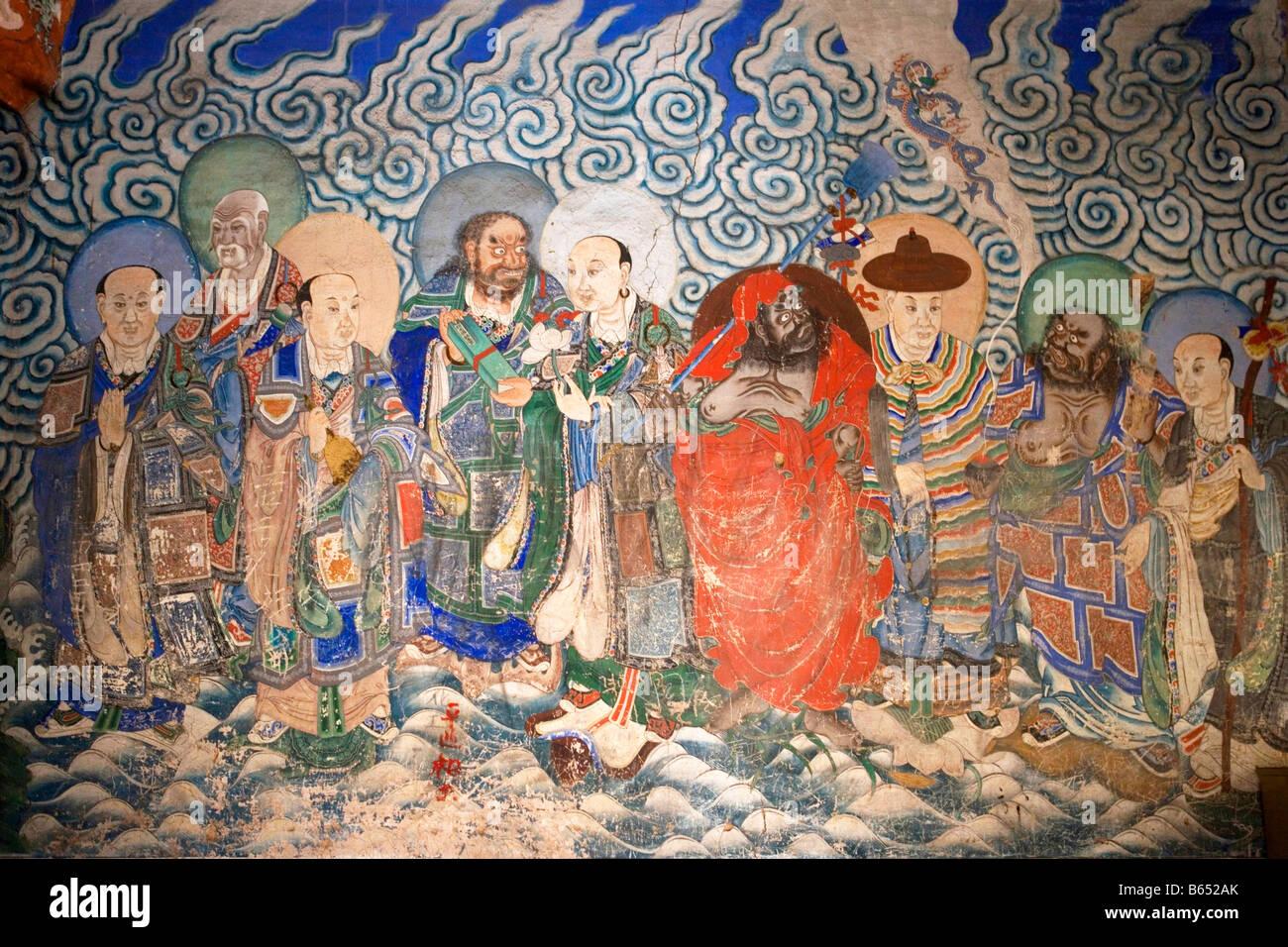 Wall painting of Arhats, Yungang Grottoes, Shanxi Province, China - Stock Image