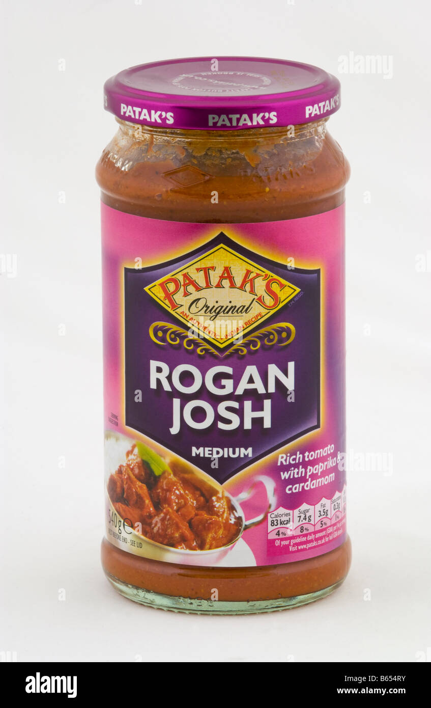 Jar of Pataks Rogan Josh medium curry cooking sauce sold in the UK - Stock Image
