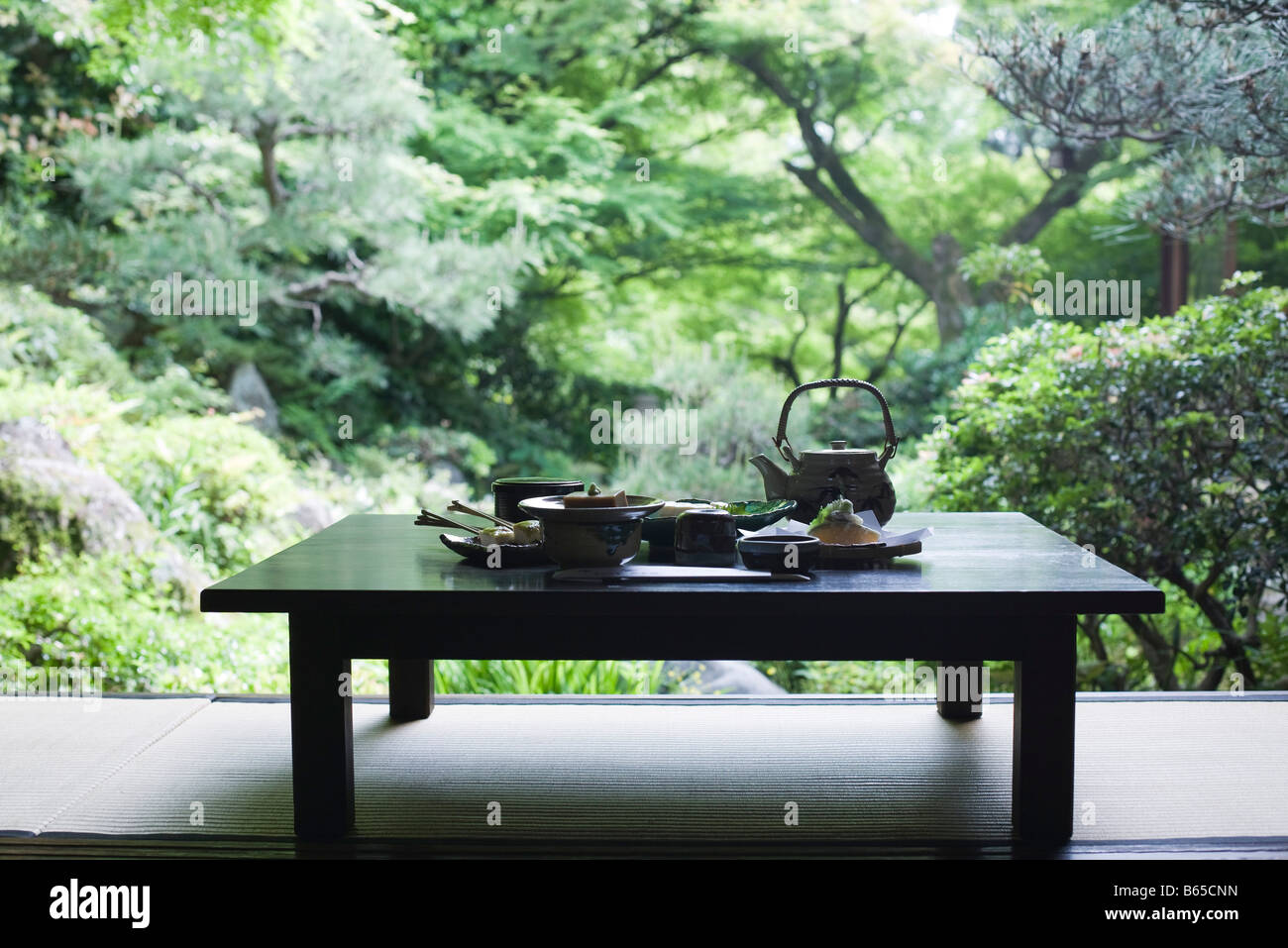 Traditional Japanese meal on table outdoors - Stock Image