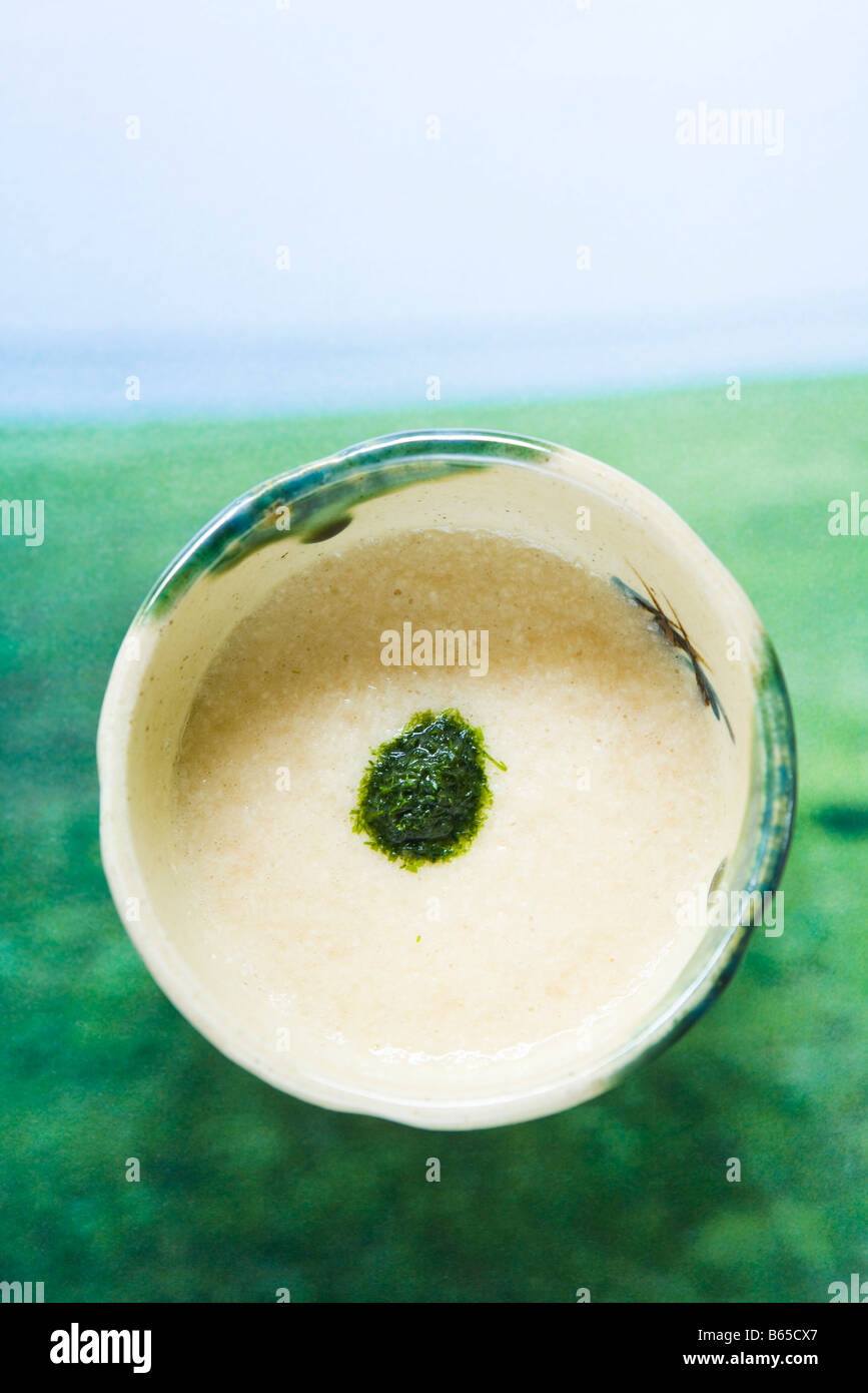 Bowl of savory Japanese soy cream with raw shiso paste, overhead view Stock Photo