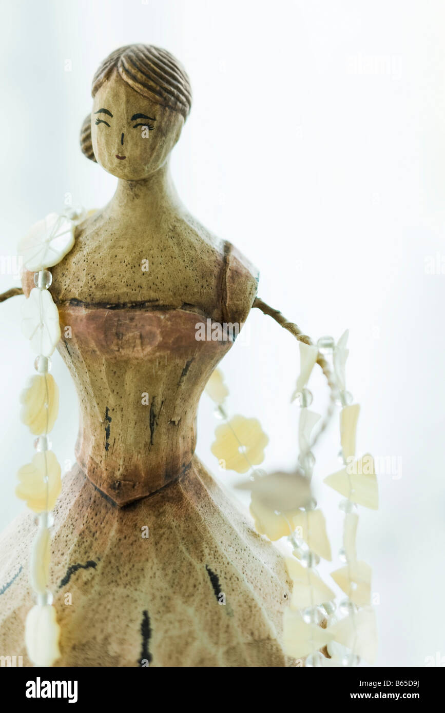 Necklace draped across wooden necklace doll stand - Stock Image
