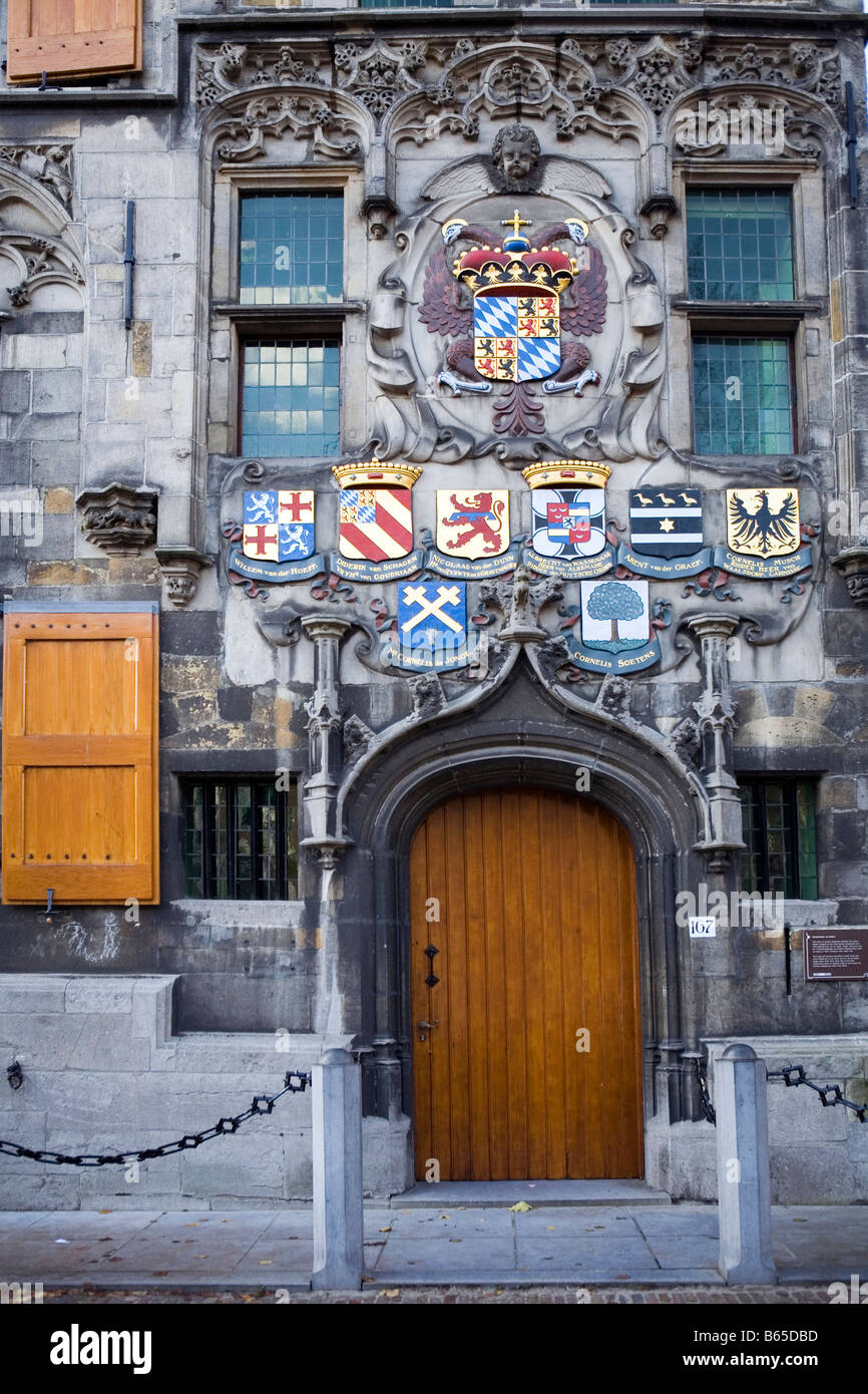 Sheilds on sandstone facade of Oude Delft 167, Delft, The Netherlands - Stock Image