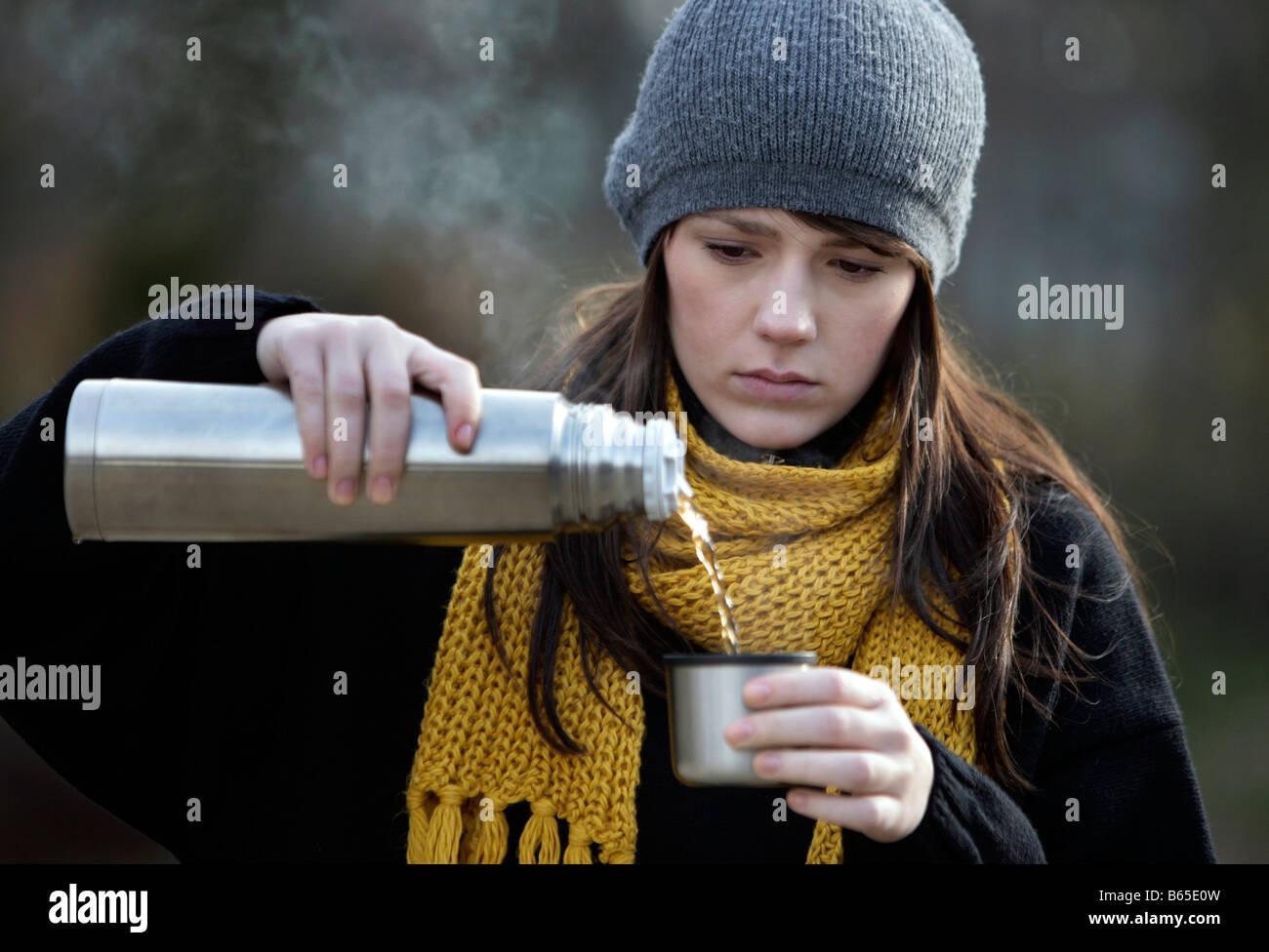 Young Girl drinking Tea - Stock Image
