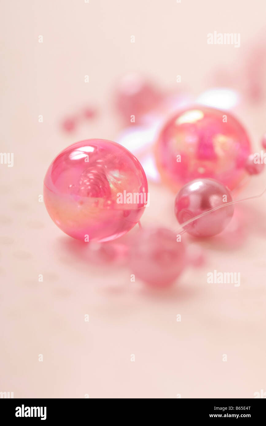 Decorative pink beads, close-up - Stock Image