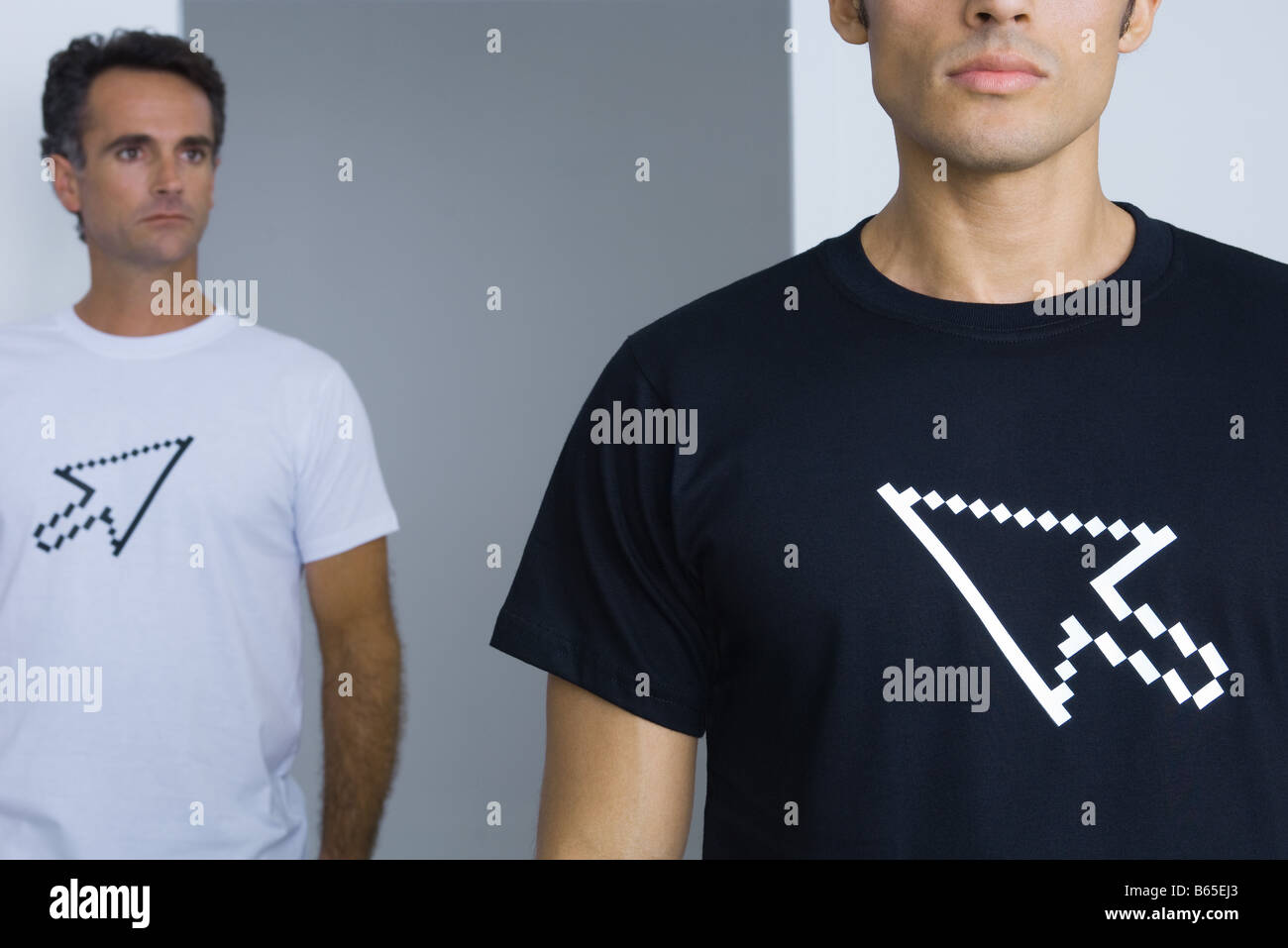 Men wearing tee-shirts printed with computer cursors, cropped - Stock Image