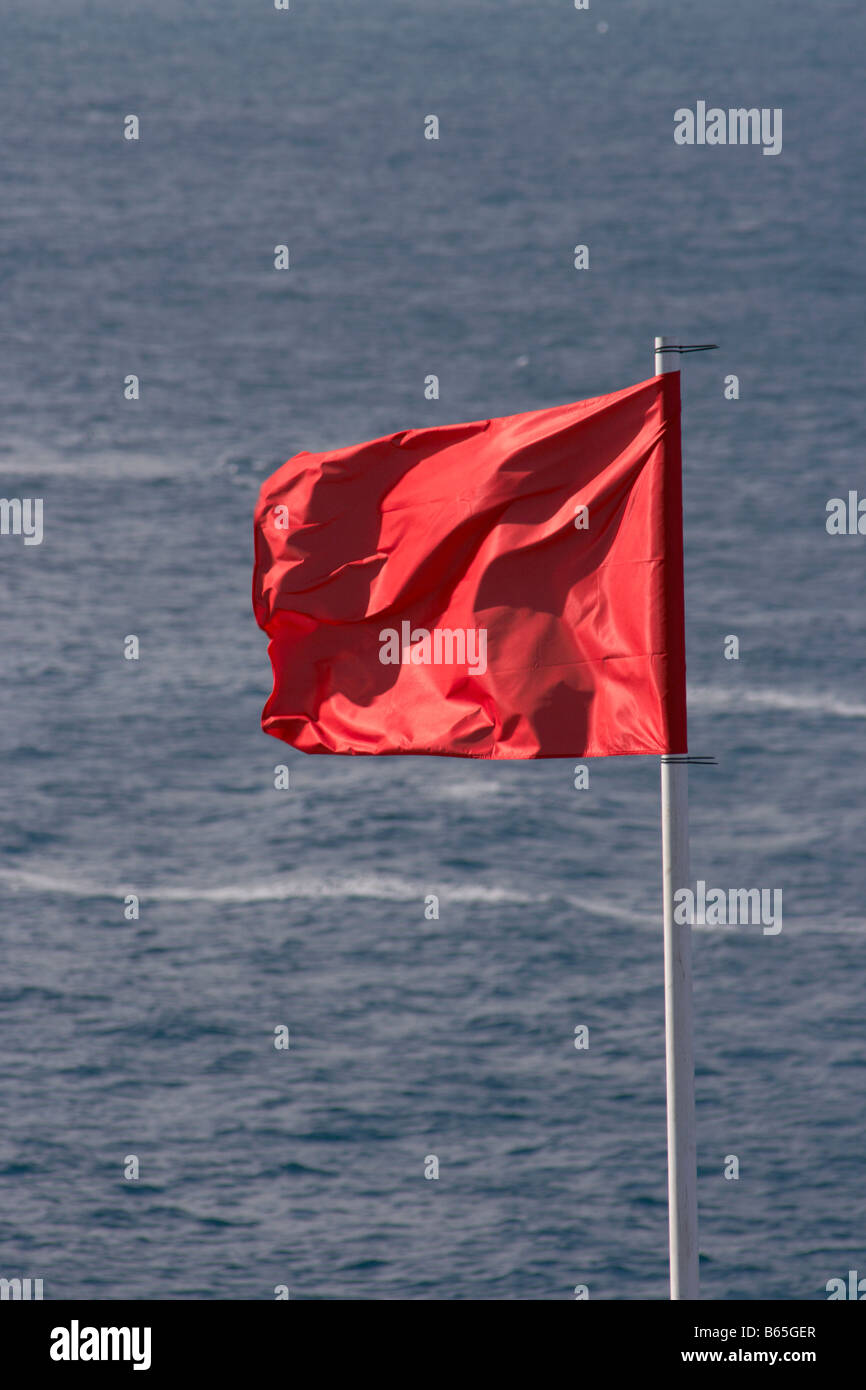 Red flag on beach in Spain - Stock Image