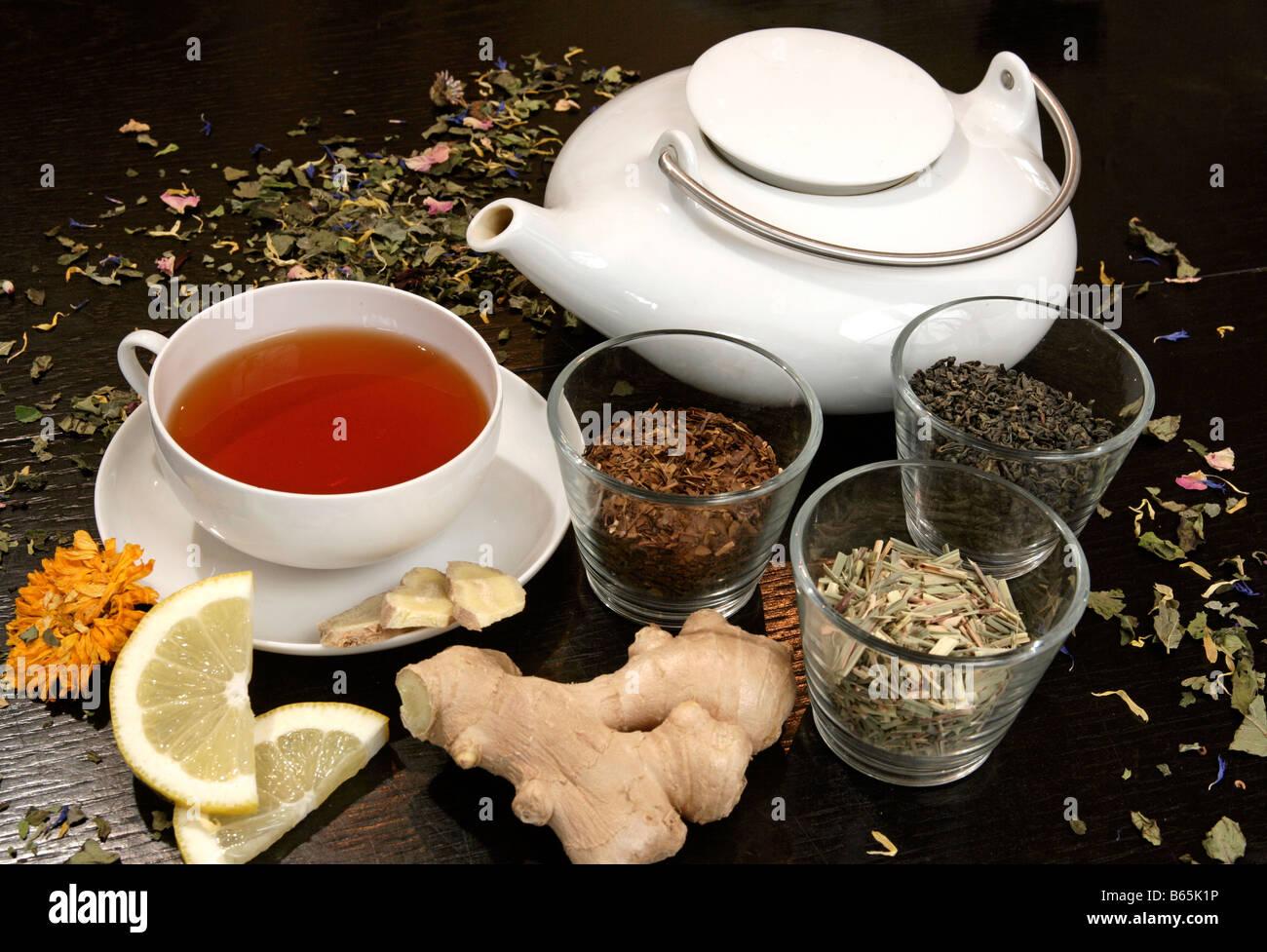 Tea still life with rooibos tea & teacup, teapot, lemon and ginger - Stock Image
