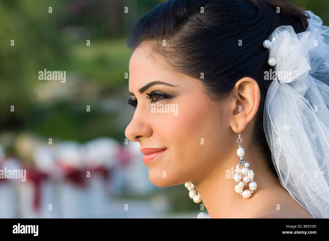 Profile portrait of a beautiful Middle Eastern Bride - Stock Image