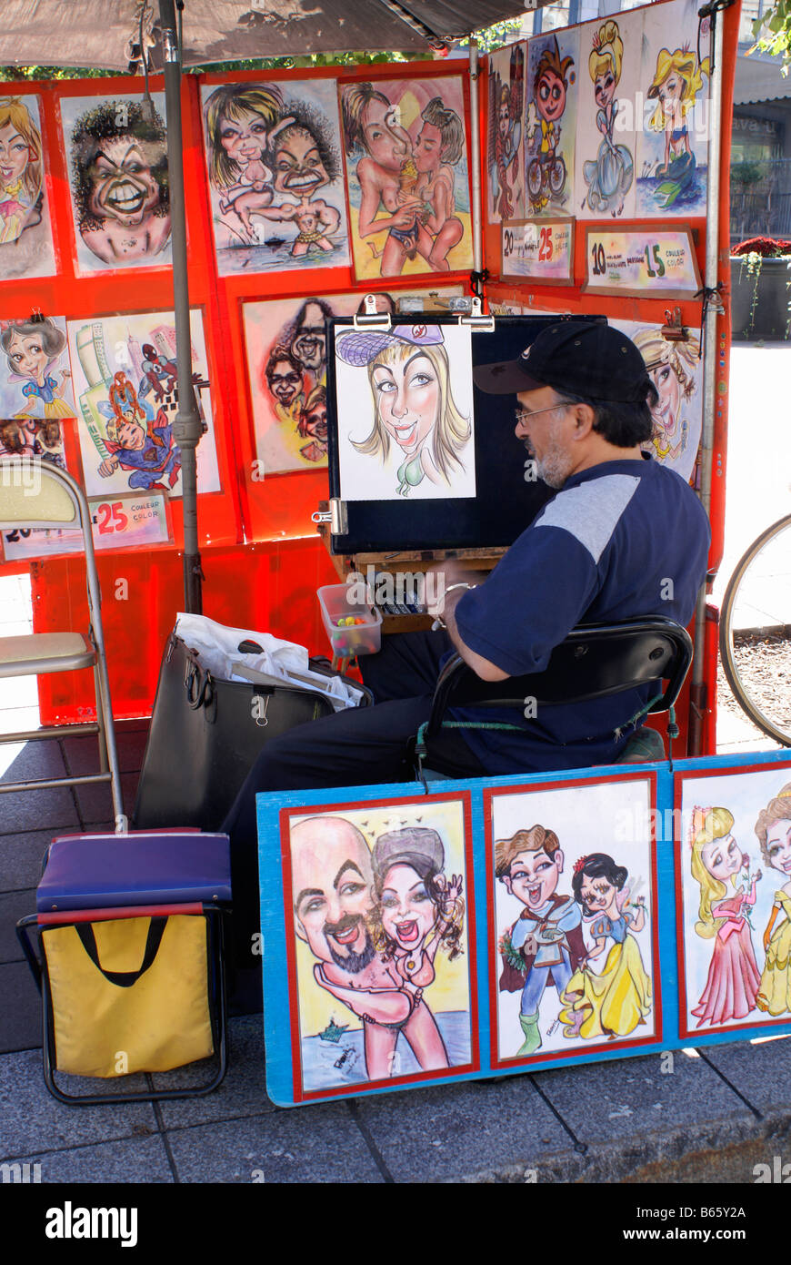 Sidewalk artist selling his caricatures in Place Jacques Cartier, Old Montreal, Quebec, Canada - Stock Image